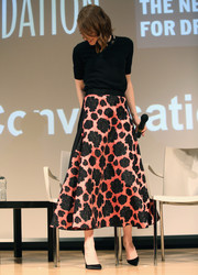 A coral and black floral-embroidered skirt, also by Lanvin, completed Emma Stone's sweet-looking outfit.