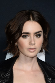 Lily Collins was a cutie at the Saint Laurent show with her short wavy 'do.
