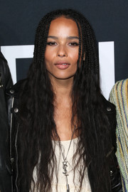 Zoe Kravitz wore her hair braided at the top and wavy down the ends during the Saint Laurent show.