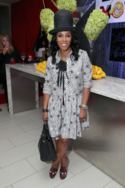 June Ambrose kept it youthful in a gray floral shirtdress at the Saks Fifth Avenue exclusive collection launch.