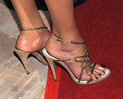 Catherine Zeta-Jones attended SBIFF's 2011 film honors wearing strappy gold sandals and deep burgundy nail polish. She also smoothed a shimmering golden lotion on her legs to complete the glamorous look.