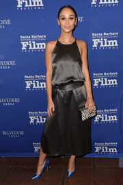 Cara Santana tied her look together with a patterned box clutch.
