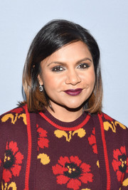 Mindy Kaling accentuated her eyes with smoky gray shadow.