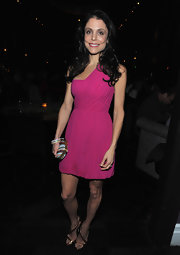 Bethenny Frankel paired metallic gold heeled sandals with her fuchsia frock for the celebration for her 'Self' magazine cover.