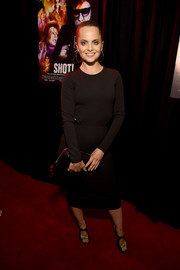 Mena Suvari went minimalist in a long-sleeve LBD with waist cutouts for the premiere of 'Shot! The Psycho-Spiritual Mantra of Rock.'