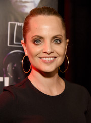 Mena Suvari slicked her hair back into a bun for the premiere of 'Shot! The Psycho-Spiritual Mantra of Rock.'
