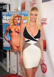 Genevieve Morton went for a modern, sexy look with a tricolor bandage dress at the SI Swimsuit launch party.