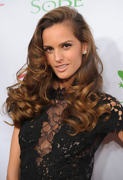 Izabel Goulart showed off luscious and bouncy curls are the SI Swimsuit Launch Party.