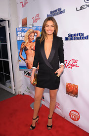Alyssa Miller opted for chic footwear, wearing black peep-toe sandals.