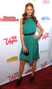 Cintia Dicker's fondness for small purses showed as she carried another one at a Sports Illustrated party.