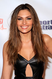 Alyssa Miller attended a 'Sports Illustrated' event wearing her long locks with lots of wind-blown texture.