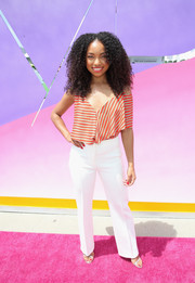 Logan Browning was modern-chic in an asymmetrical striped blouse at the SIMPLY Los Angeles Fashion + Beauty Conference.