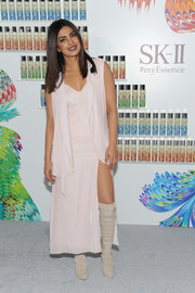 Priyanka Chopra gave her look an edgy boost with a pair of nude knee-high boots.