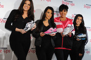 (L-R) Television personalities Khloe Kardashian, Kim Kardashian, Kris Jenner and Kourtney Kardashian attend a press conference announcing the partnership between Kim Kardashian, Kris Jenner and SKECHERS at the Regent Beverly Wilshire Hotel on November 22, 2010 in Los Angeles, California.