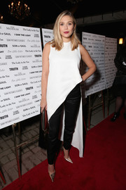 Elizabeth Olsen chose tapered black silk pants, also by Juan Carlos Obando, to complete her outfit.