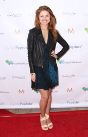 Anna Trebunskaya stepped out on the red carpet in casual nude platform sandals, a tie-dye dress, and a zip-up jacket during the Live Love Spa event.