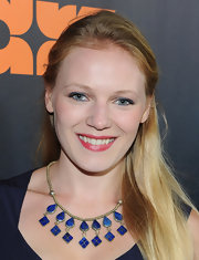 Emma Bell was all about blue accents at the premiere of Starz 'Boss'. Her echoed her blue statement necklace with soft blue eye pencil applied to her top and bottom lash lines and the inner rims of her eyes.