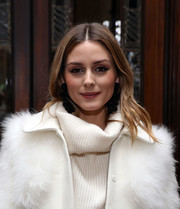 Olivia Palermo sported soft, center-parted waves at the Sachin & Babi fashion show.