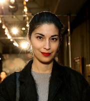 Caroline Issa finished off her look with a swipe of red lipstick.