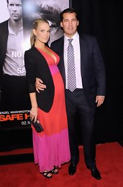 Molly Sims topped off her color-blocked maternity dress with platform strappy sandals.