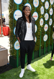 Tina Charles brought an edgy vibe to Safe Kids Day with this moto-chic black leather jacket.