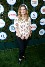 Drew Barrymore chose a pair of tapered black slacks to complete her casual getup.