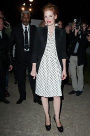 Jessica Chastain finished off her feminine polka-dot frock with classic black platform pumps.