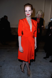 Jessica Chastain was a classy lady in red with this vibrant dress at the Saint Laurent runway show.