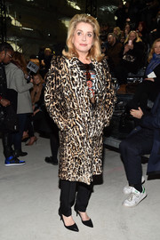 Catherine Deneuve was classic and luxe in a leopard-print fur coat while attending the Saint Laurent fashion show.