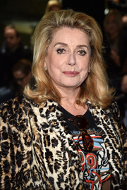Catherine Deneuve brought a retro vibe to the Saint Laurent show with this '60s-inspired hairstyle.
