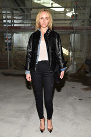 Amber Valletta was equal parts tough and sexy in a black Saint Laurent leather jacket and a pair of skintight jeans while attending the brand's fashion show.