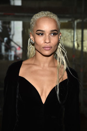 Zoe Kravitz wore her hair in a partially braided, half-up style when she attended the Saint Laurent fashion show.