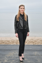 Amber Heard teamed her jacket with black trousers.