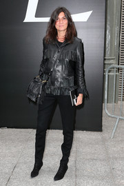Emmanuelle Alt was hippie-edgy in a fringed black leather jacket during the Saint Laurent fashion show,