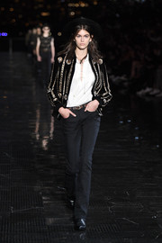 Kaia Gerber looked cool in an embellished bomber jacket while walking the Saint Laurent runway.