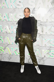Jasmine Sanders showed off her winter style with this bulky green leather jacket at the Saks celebration.