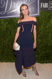 Diane Kruger looked cool and modern in a navy and orange cold-shoulder midi dress by Jason Wu at the Vanity Fair 2016 International Best Dressed List celebration.
