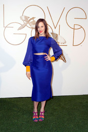 Liz Goldwyn sported a striking mix of colors in a royal-blue cutout dress with mustard cuffs during the LoveGold party honoring Lupita Nyong'o.