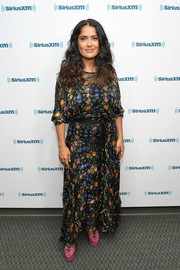 Salma Hayek went the sweet and feminine route in a floral maxi dress by Preen for her visit to SiriusXM.
