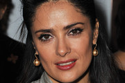 Salma Hayek Wears Glam Hairstyle at Yves Saint Laurent Fashion Show