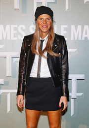 Anna dello Russo went for an edgy menswear-inspired look with a narrow black tie teamed with a moto-chic leather jacket during the Salone Internazionale del Mobile celebration.