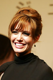 Angeline Jolie paired her green dangle earrings with a high updo.