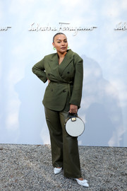 Paloma Elsesser completed her white accessories with a circular purse, also by Ferragamo.