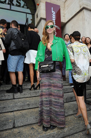 Chiara Ferragni brought a bright pop of color to the Salvatore Ferragamo fashion show with this green leather jacket.