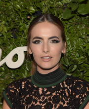 Camilla Belle tempered her bold eye makeup with a nude lip.