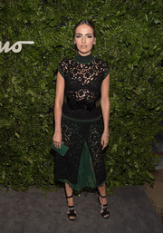 Camilla Belle flashed plenty of skin in a see-through black and green lace dress by Ferragamo during the label's celebration of 100 years in Hollywood.