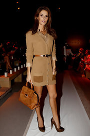 Tulin showed off a tan suede tote bag while hitting Milan Fashion Week.