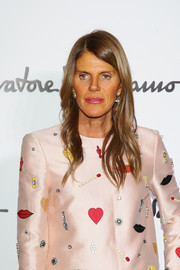 Anna dello Russo decided to go hatless to show off her lovely waves at the Ferragamo fashion show.