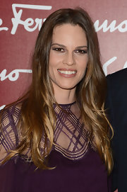 Hilary Swank wore her hair in long shiny layers while attending an exhibit at the Louvre in Paris.