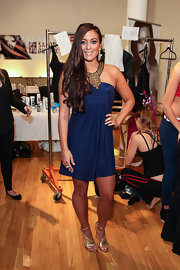 Sammi Giancola shined at her runway debut in these shimmering gold stripy sandals.